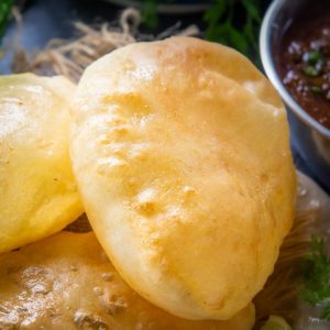 Bhatura is a fluffy, puffed, and deep-fried Indian bread that is famously served with golden brown chickpea curry (Punjabi Chole) in India. Learn how to make the best Bhatura at home using my simple recipe.