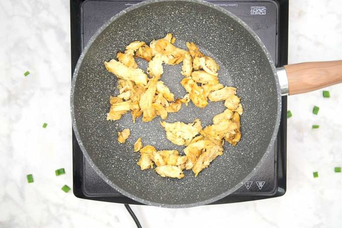 Chicken cooked until browned.