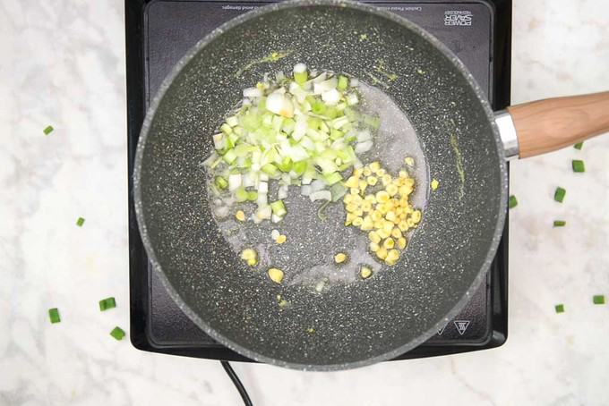 Garlic and Spring onion white added in the pan.