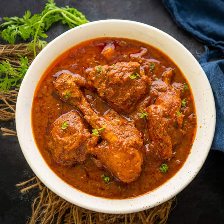 This Authentic Goan Chicken Vindaloo Recipe is a traditional Goan dish with fiery red color and a slight tang from the vinegar. It pairs very well with rice or any Indian bread. Here is how to make it just like a Goan Home.