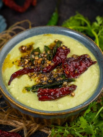 This South Indian Green Cilantro Coconut Chutney is a delicious variation of the classic coconut chutney and it goes very well with idli, dosa, uttapam, and vada. Make it using my simple recipe.