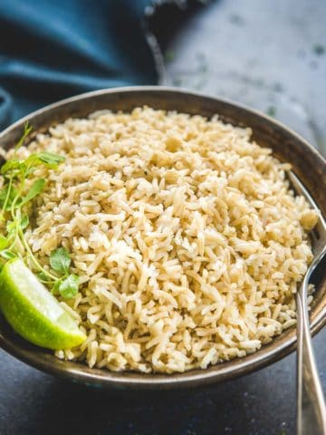 Learn how to cook Instant Pot Brown Rice in 20 minutes. Cooking brown rice in an Instant pot cooks the rice perfectly every single time and cuts short the cooking time half. No soaking, no babysitting the pot, no mushy, uncooked, or burnt rice anymore!