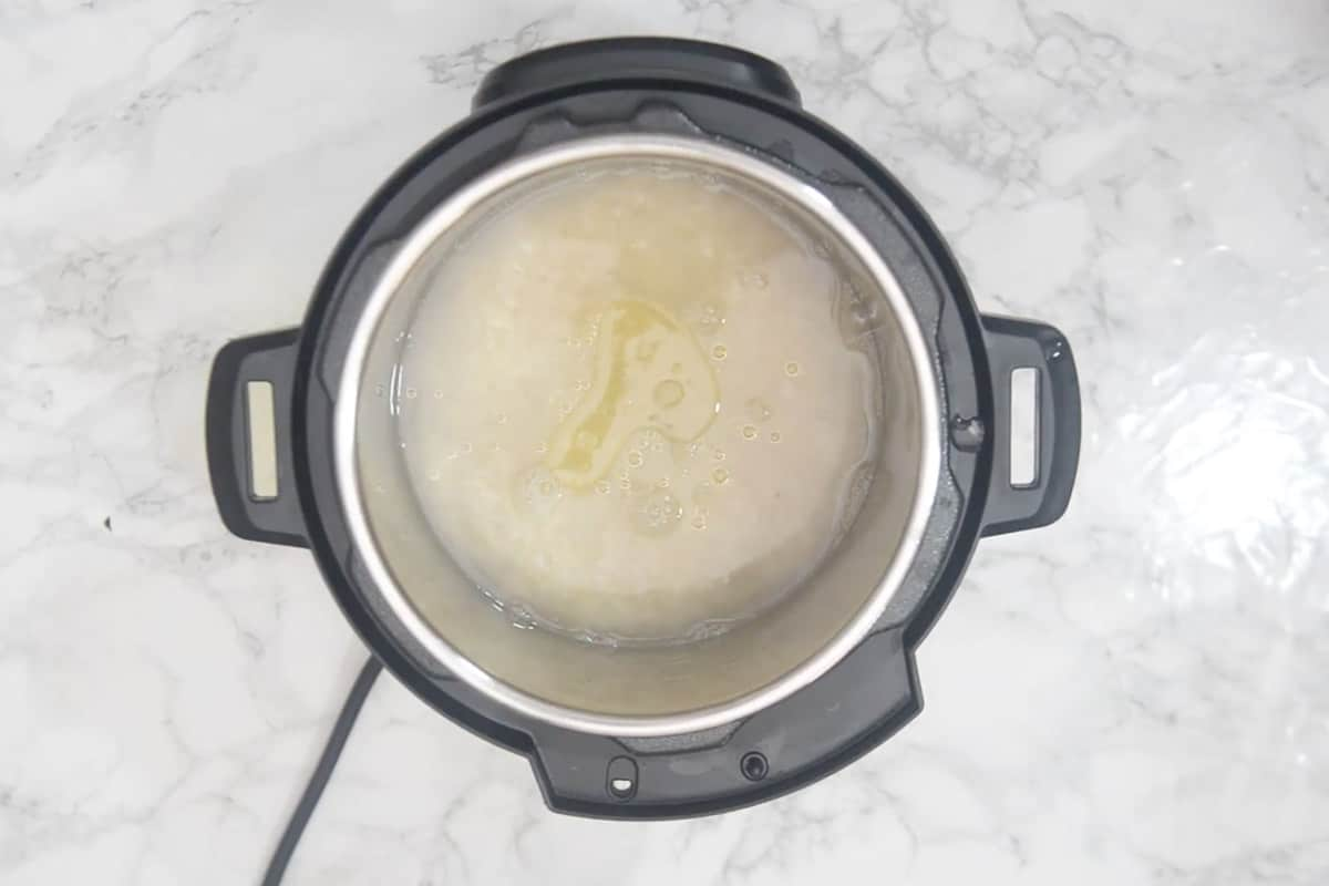 Water, lemon juice, salt, and oil added to instant pot