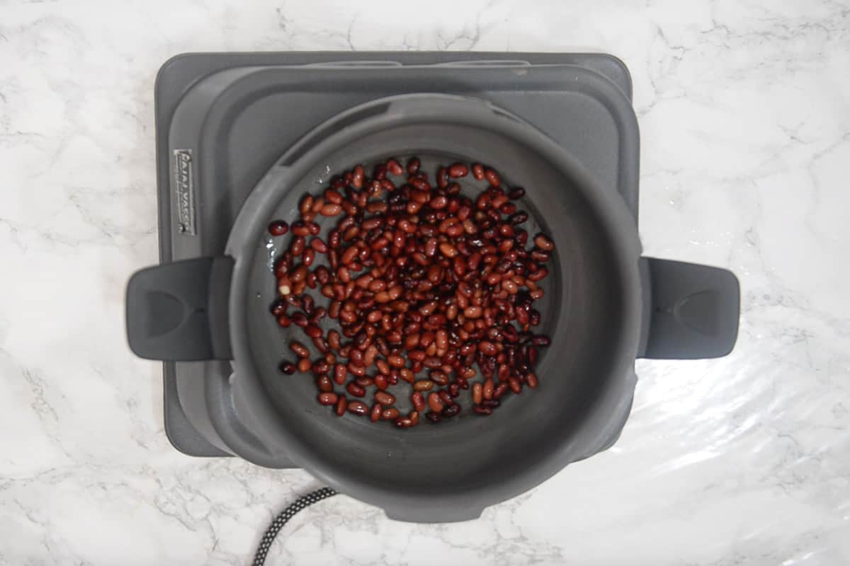 Soaked beans added in a pressure cooker.