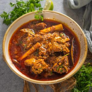 Laal maas is a traditional Rajasthani mutton curry that is fiery hot and deep red in color. Make it at home using my authentic recipe.