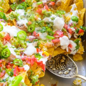 These homemade fully Loaded Nachos are a great party appetizer. Easy and simple to make, you can make these in a jiffy and in a large batch. Here is how to make these at home.
