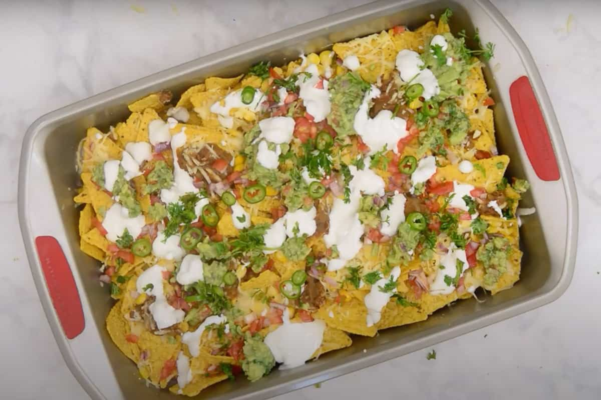 Topped with jalapeño, tomato salsa, sour cream, guacamole, and fresh coriander