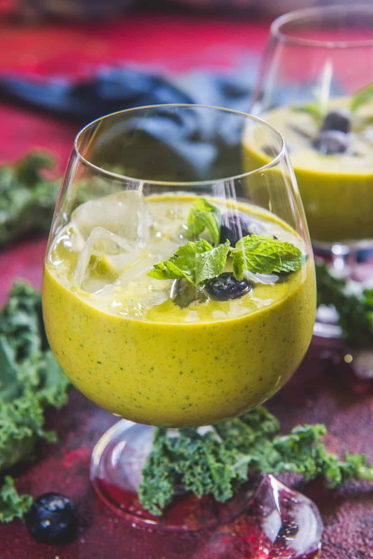 Mango kale smoothie served in a bowl.
