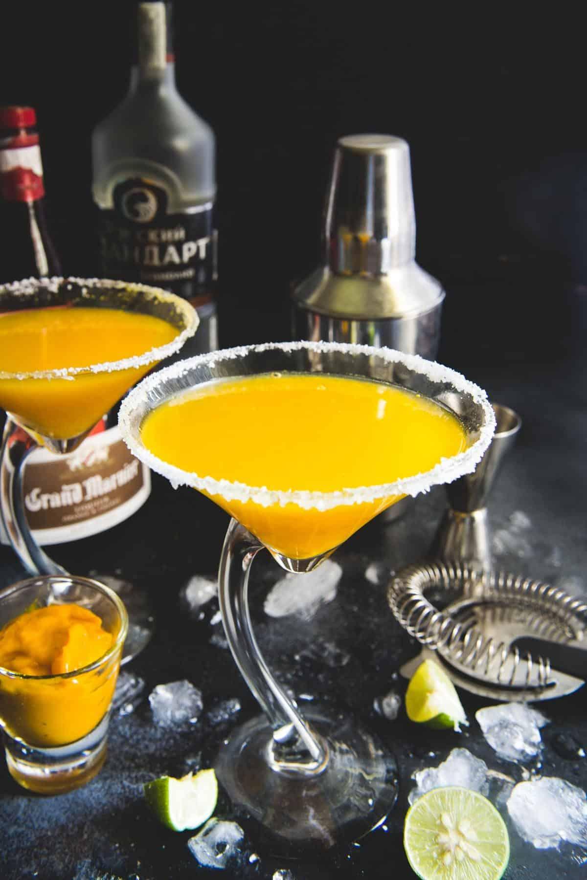 Mango martini served in a glass.