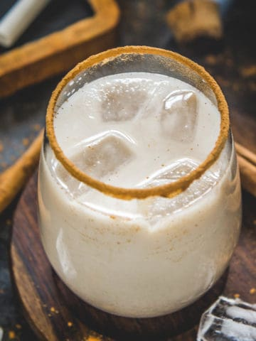 Make this refreshing traditional Mexican Horchata Drink at home using pantry staples and 15 minutes of cook time. This homemade drink is creamy, earthy, nutty, and perfect to sip on hot summer days.