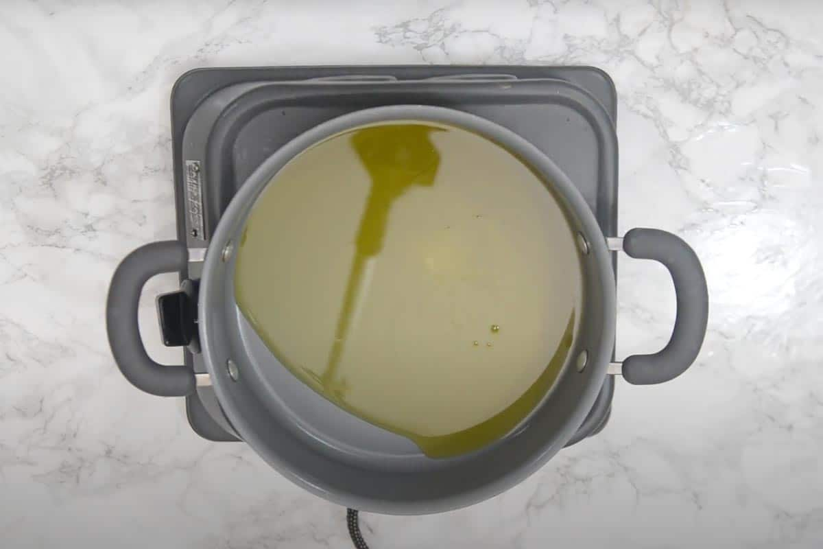 Ghee heating in a non stick pan.