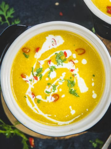 Velvety creamy with warm and cozy fall flavors, this Pumpkin Curry Soup is super easy to make and can be done in under 20 minutes. It is naturally gluten-free, vegan, dairy-free and the recipe is very flexible.