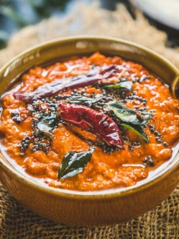 Looking for a different Chutney recipe to go with Idli Dosa? Red Coconut Chutney is a delicious and easy to make South Indian Style chutney that tastes delicious with dosa and idli and it comes together in just 10 minutes.