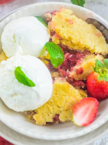 Strawberry Cobbler is easy to make classic Southern dessert made using fresh strawberries. It takes all of 6 simple ingredients and 15 minutes to put it together and makes for a great party dessert. Here is how to make it.