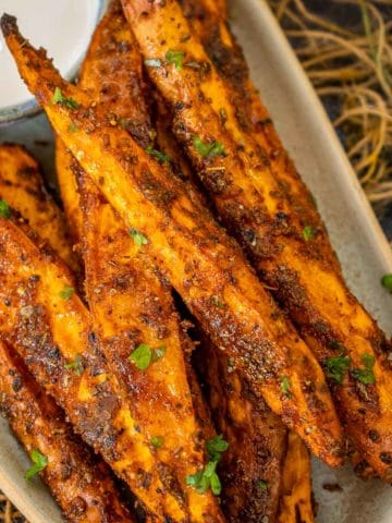 Crispy outside, creamy inside, and lightly spiced, these oven-roasted sweet potato wedges make for a healthy appetizer, snack, or side dish (vegan, gluten-free).