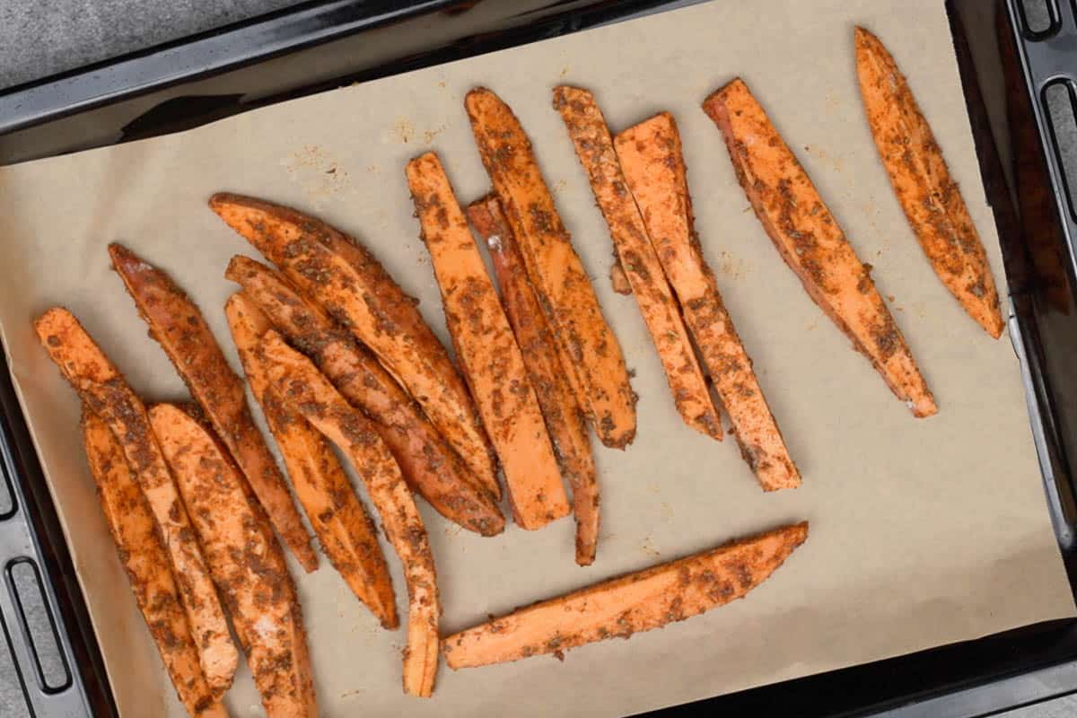 Wedges arranged on a baking tray lined with parchment.