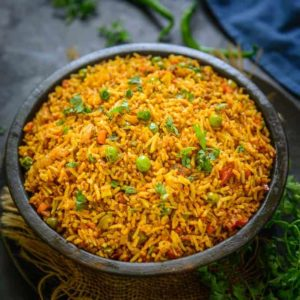 Tawa Pulao is a popular Mumbai street food and is super easy to make. Leftover rice works best for this recipe and is a super hit with kids too.
