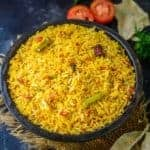 Tomato Rice is a delicious South Indian style rice recipe which is super quick to make. make it for breakfast, lunch or dinner, it fits it all.