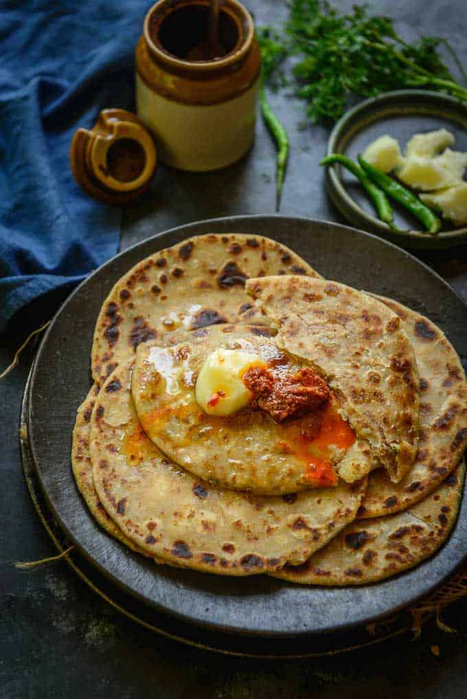 Aloo Paratha served with butter and pickle.