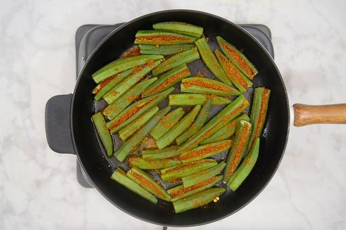 Stuffed bhindi arranged on the pan.