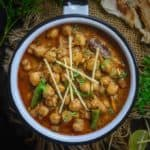 Make this Punjabi Restaurant Style Chana Masala at home using my easy and simple recipe. This recipe gets ready in under 30 minutes and is gluten free too. Just skip curd and ghee to make it vegan as well. Here is how to make Chana Masala Recipe.