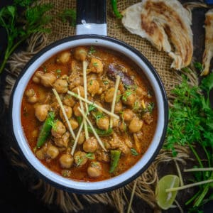 Make this homemade Punjabi Restaurant Style Chana Masala using my easy and simple recipe. This recipe gets ready in under 30 minutes and is and gluten-free too. Just skip yogurt and ghee to make it vegan as well.