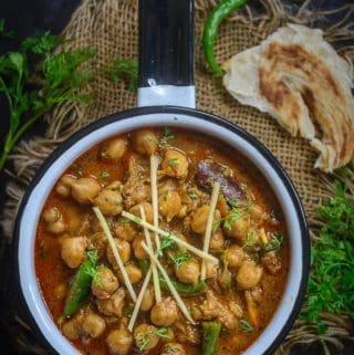 Chana Masala served in a pan.