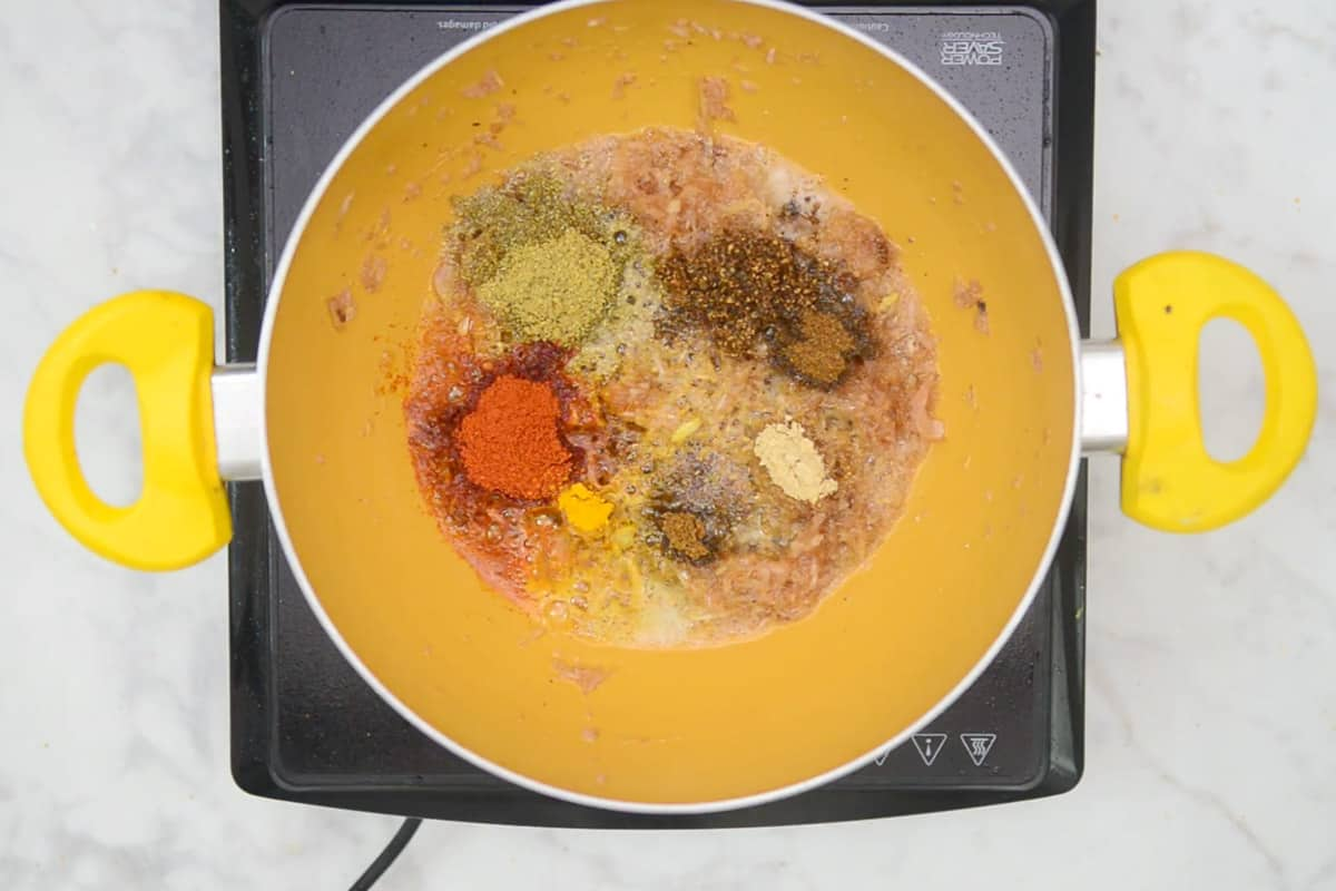 Dry spice powders added in the pan.