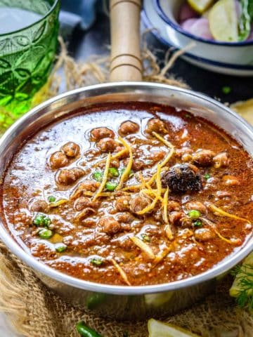 Punjabi Chole Masala is a spicy curry from the northern region of India. Made from chickpeas, onion, tomatoes, ginger, garlic, and Indian spices, it is one of the most delicious curries to try if you like Indian food. Make this Chole Masala in under 30 minutes in one pot.
