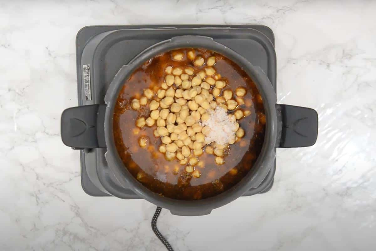 Soaked chole, tea water, baking soda, salt and 1 cup water added in the cooker.