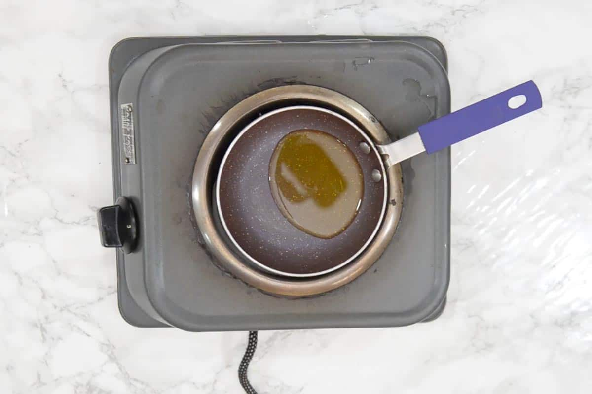 Ghee for tempering in a pan.