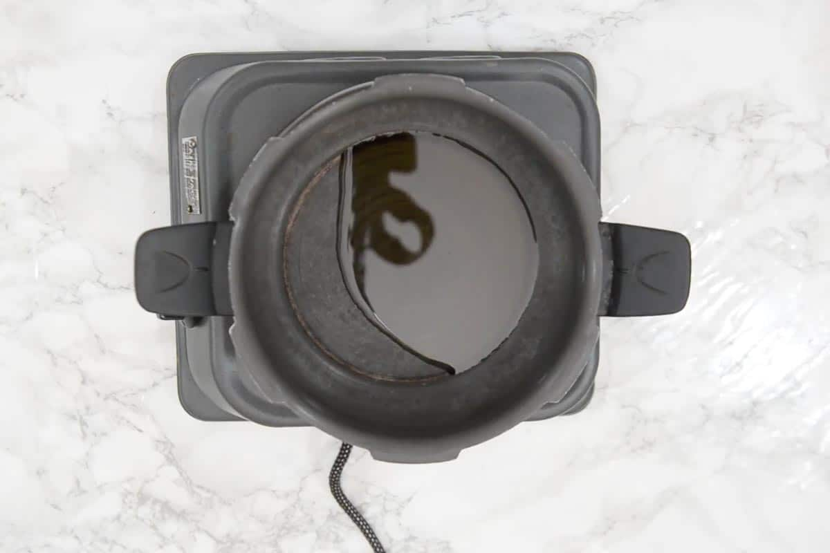 Oil heating in a pressure cooker.