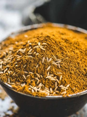 Make this super fragrant roasted cumin powder (ground cumin) at home in under 10 minutes. It's much economical to make at home and all you need is cumin seeds and a grinder.