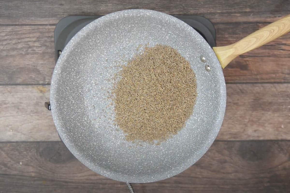 Cumin added to the skillet.