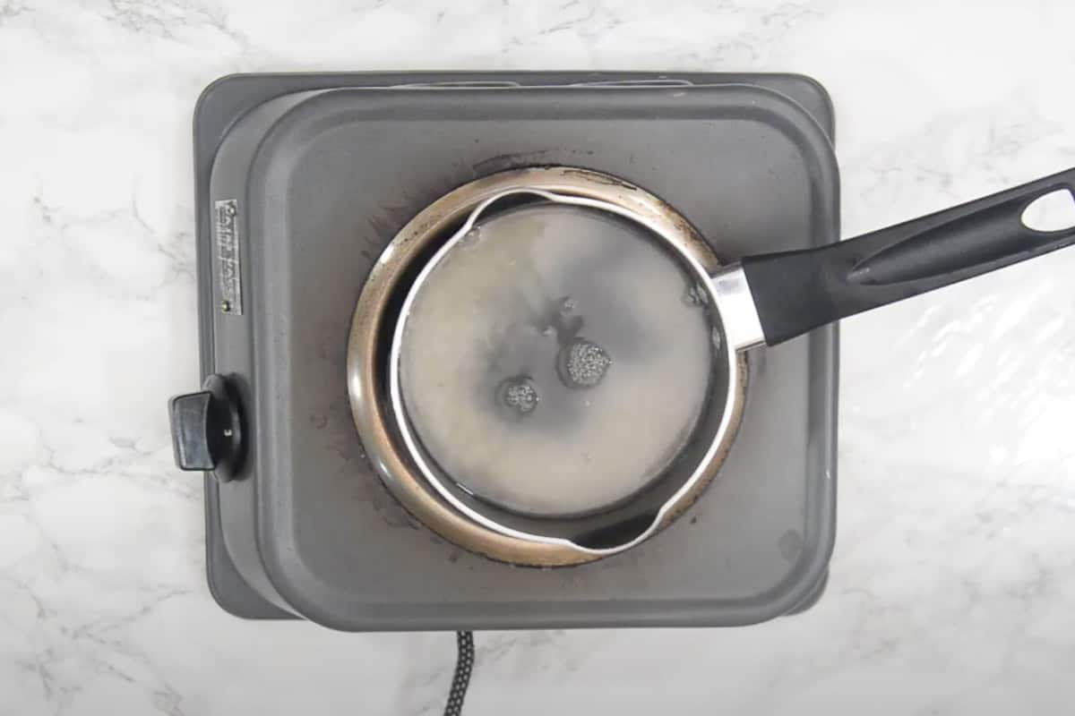 Rice cooking with water.