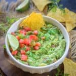 Make this easy and best homemade Guacamole Dip at home in under 10 minutes. This Authentic Mexican Dip is healthy, Vegan, Gluten Free and super simple to make. Here is how to make Guacamole Recipe.