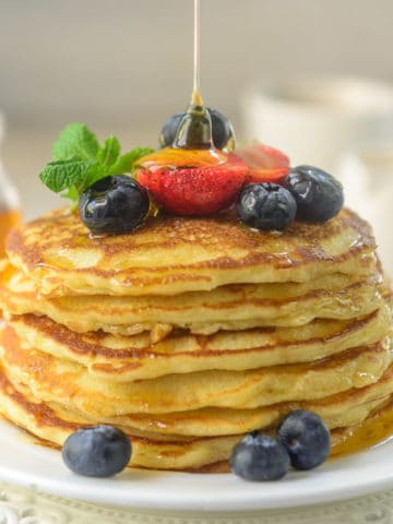 This old fashioned pancakes recipe makes the best homemade pancakes from scratch. The thick, fluffy pancakes are a delight to eat and super simple to make.