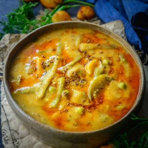 Sindhi Kadhi is a tangy accompaniment that tastes marvellous with steamed rice. It can be made using curd or with tomatoes. Here is how to make Sindhi Kadhi Recipe.