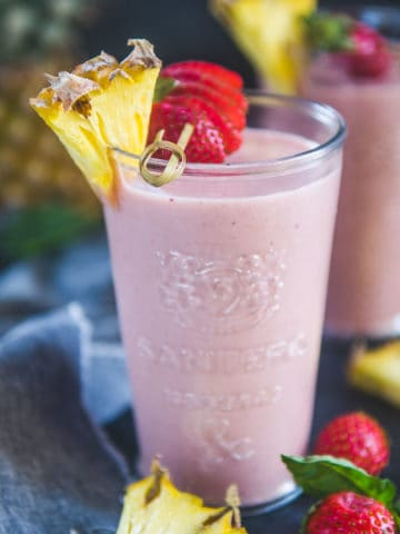 This 5 Minute Strawberry Pineapple Smoothie is the best way to start your day. It's easy to make, very healthy, refreshing, great for weight loss, and can be turned into a vegan version too. Here is how to make it.