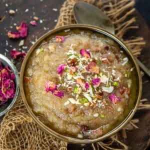 Rich, indulgent, super easy to make, that's Suji Ka Halwa you guys! It is Indian Semolina Pudding which can be made using three ingredients in just no time. Serve it for dessert or as breakfast.