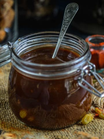 Sweet and Sour Tamarind Chutney or Imli ki Chutney (Sonth) is a delicious Indian sauce made using tamarind, jaggery, and spices. This easy to make chutney can be used for making Bhel Puri, can be served with samosa and is an integral part of any Indian Chaat.