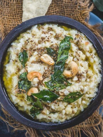 Pongal is a South Indian-style porridge made using rice and yellow moong lentil. It can be made sweet or savory. The savory version is called Ven Pongal or Khara Pongal. Sharing the recipe to make the savory version below. Make this protein-packed dish in 30 minutes.