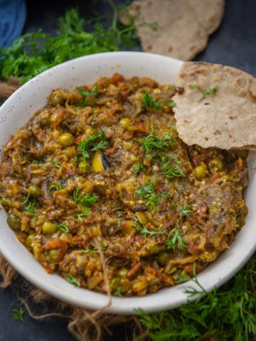 This smoky Baingan Bharta is a delicious Indian style eggplant mash which is great to serve with naan or paratha. It's vegan, gluten-free, and comes together in 30 minutes.