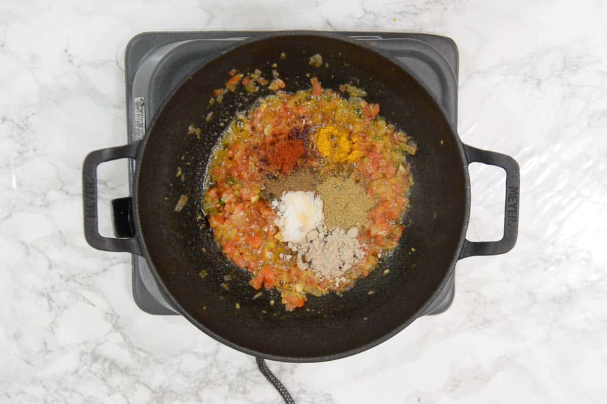 Dry spices and ½ cup water added in the pan.