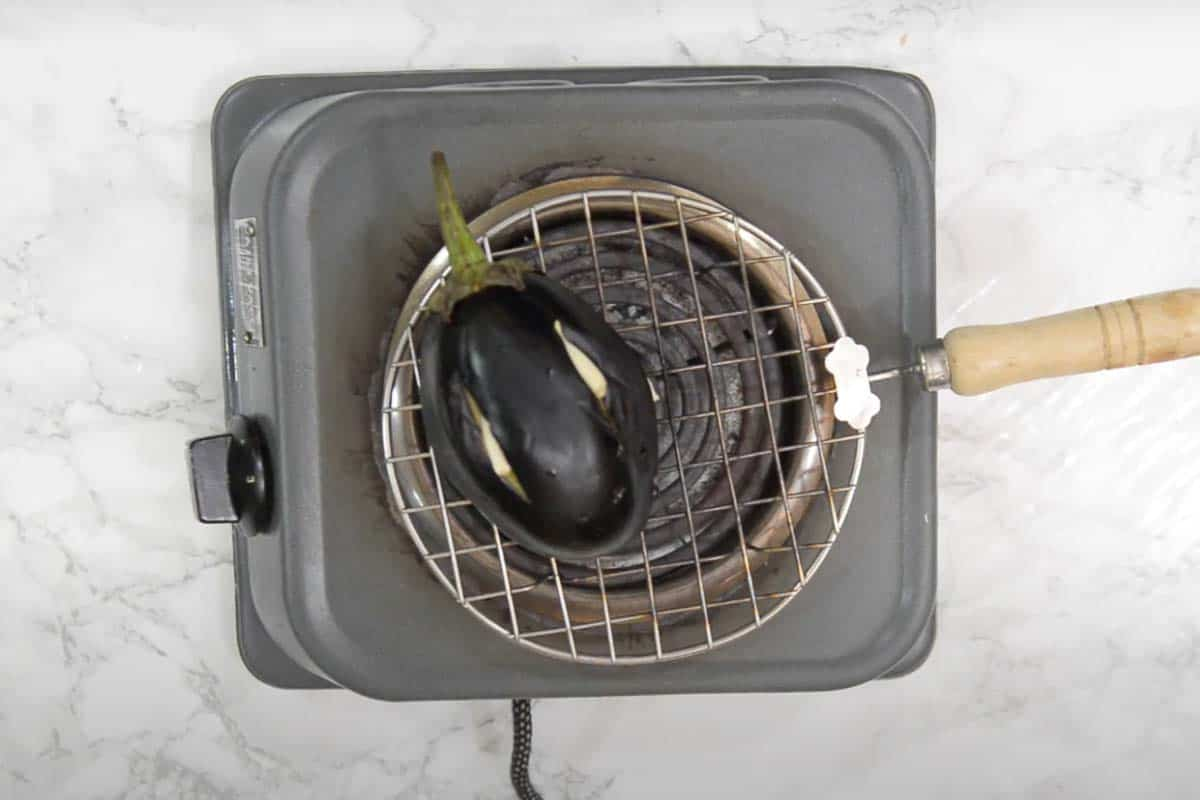 Eggplant roasting over direct flame.