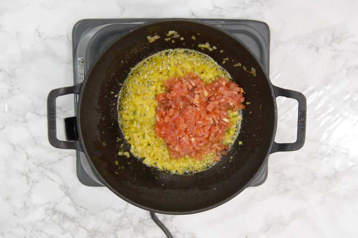 Tomatoes added in the pan.