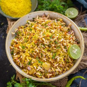 Bhel puri is a popular Indian street-style snack made using puffed rice as its base ingredient. This tangy, spicy and very slightly sweet chaat can be made in just 10 minutes if you have the ingredients ready. Here is my easy recipe to make at home.