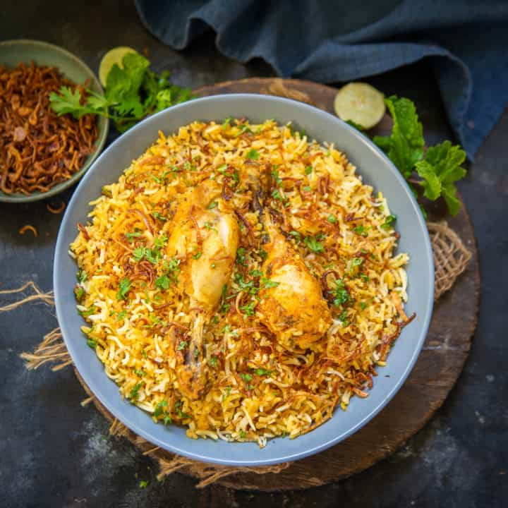 Hyderabadi Chicken Biryani boasts of a beautiful cacophony of flavours that is known the world over. A delicious medley of fine long grain rice spices and chicken pieces, this Hyderabad style dum biryani is very easy to make and a delight to eat. Here is how to make it at home.