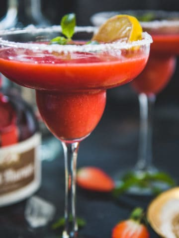 Make this refreshing 5 ingredient frozen strawberry margarita in a blender in under 5 minutes. Serve it for BBQ, potlucks, or summer outdoor parties, it's going to be a hit.