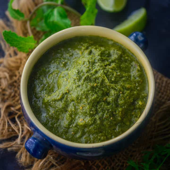 This Spicy & tangy Green Chutney or Hari Chutney is made primarily using fresh coriander and mint. This Indian accompaniment is best to serve with snacks or with Indian meals. Here is how to make it.
